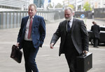 United Kingdom's Brexit advisor David Frost, left, and British Ambassador to the EU Tim Barrow arrive at EU headquarters for a technical meeting on Brexit at EU headquarters in Brussels, Tuesday, Oct. 8, 2019. (AP Photo/Virginia Mayo)