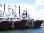 This Sept. 13, 2019 photo shows commercial fishing vessels at port in Barnegat Light, N.J. Although they support efforts to fight climate change and its impact on the world's oceans, the fishing industry fears it could be harmed by one of the promising solutions: the offshore wind energy industry. At a Congressional subcommittee hearing Monday Sept. 16, 2019 in New Jersey, fishermen asked for a seat at the table when important wind energy decisions are made, including where projects are located. (AP Photo/Wayne Parry)