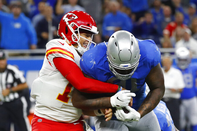 Kansas City Chiefs quarterback Patrick Mahomes (15) tackles Detroit Lions defensive tackle A'Shawn Robinson (91) after Robinson picked up a fumble during the second half of an NFL football game, Sunday, Sept. 29, 2019, in Detroit. (AP Photo/Paul Sancya)