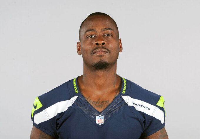 "FILE - This is a 2015 file photo showing Tarvaris Jackson of the Seattle Seahawks NFL football team. Former NFL quarterback Tarvaris Jackson has died in a one-car crash outside Montgomery, Ala., authorities said Monday, April 13, 2020. He was 36. The 2012 Chevrolet Camaro that Jackson was driving went off the road, struck a tree and overturned at 8:50 p.m. Sunday, Trooper Benjamin ""Michael"" Carswell, an Alabama Law Enforcement Agency spokesman, said in a news release. Jackson was pronounced dead at a hospital. (AP Photo/File)"