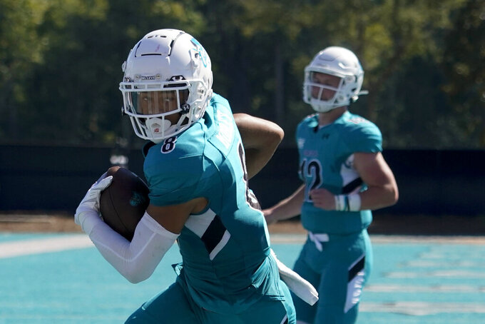 Coastal Carolina wide receiver Tyson Mobley runs for a touchdown Massachusetts during the second half of an NCAA college football game on Saturday, Sept. 25, 2021, in Conway, S.C. (AP Photo/Chris Carlson)