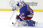 New York Rangers goaltender Henrik Lundqvist makes a save against the Boston Bruins during the first period of an NHL hockey game, Sunday, Oct. 27, 2019, at Madison Square Garden in New York. (AP Photo/Mary Altaffer)