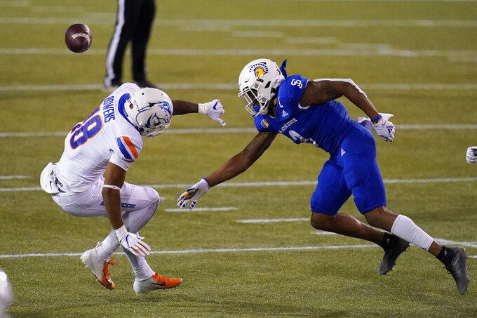 San Jose State safety Tre Webb, right, forces Boise State wide receiver Billy Bowens (18) to miss a catch during the second half of an NCAA college football game for the Mountain West championship, Saturday, Dec. 19, 2020, in Las Vegas. (AP Photo/John Locher)