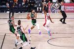 Boston Celtics' Jayson Tatum (0) drives against Miami Heat's Andre Iguodala (28) during the second half of an NBA conference final playoff basketball game Friday, Sept. 25, 2020, in Lake Buena Vista, Fla. The Celtics won 121-108. (AP Photo/Mark J. Terrill)