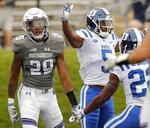 Duke's Johnathan Lloyd, center, celebrates his touchdown with teammate Brittain Brown, right, against Northwestern's Greg Newsome II during the first half of an NCAA college football game Saturday, Sept. 8, 2018, in Evanston, Ill. (AP Photo/Jim Young)