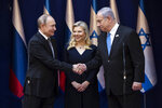 Israeli Prime Minister Benjamin Netanyahu and his wife Sarah meet with Russian President Vladimir Putin, left,  at Netanyahu official residence in Jerusalem on Thursday, Jan. 23,2020 . Putin, will be a guest of honor Thursday at a ceremony at the Yad Vashem Holocaust Museum marking the 75th anniversary of the Soviet Red Army's liberation of the Nazi Auschwitz death camp. Presidents , prime ministers and royalty from around the world who arrived in Israel for the two-day World Holocaust Forum in Jerusalem, marking the 75th anniversary of the liberation of the Auschwitz-Birkenau concentration camp.(Heidi Levine/Pool photo via AP)