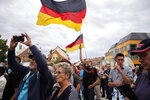 In this Thursday, Aug. 15, 2019 photo, a crowd of people attend an election campaign rally of German Alternative for Germany, AfD, party for the Saxony state elections in Bautzen, Germany. Two elections in eastern Germany's states Brandenburg and Saxony on Sept. 1, 2019, look set to bring big gains for the far-right Alternative for Germany party and another blow to the traditional parties that form the national government. (AP Photo/Markus Schreiber)