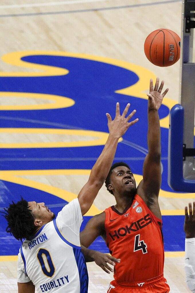 Virginia Tech's Nahiem Alleyne (4) shoots as Pittsburgh's Ithiel Horton (0) defends during the first half of an NCAA college basketball game Wednesday, Feb. 3, 2021, in Pittsburgh. (AP Photo/Keith Srakocic)