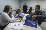 Volunteer Attorney Tania Morris Diaz, of Michigan Immigration Rights Center, works with Hameed Ali Al-Sobhi, 33, of Hamtramck, on his citizenship application, during the Detroit New Americans campaign citizenship workshop at the Yemeni American Leadership Association in Hamtramck, Mich. on Friday, April 26, 2019. (Kimberly P. Mitchell/Detroit Free Press via AP)
