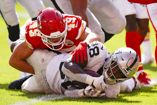 Las Vegas Raiders running back Josh Jacobs scores on a 7-yard touchdown run ahead of Kansas City Chiefs safety Daniel Sorensen (49) during the second half of an NFL football game, Sunday, Oct. 11, 2020, in Kansas City. (AP Photo/Charlie Riedel)