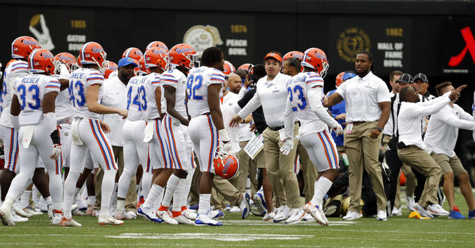 Florida players run onto the field during a confrontation between Florida and Vanderbilt coaches and players in the first half of an NCAA college football game Saturday, Oct. 13, 2018, in Nashville, Tenn. (AP Photo/Mark Humphrey)