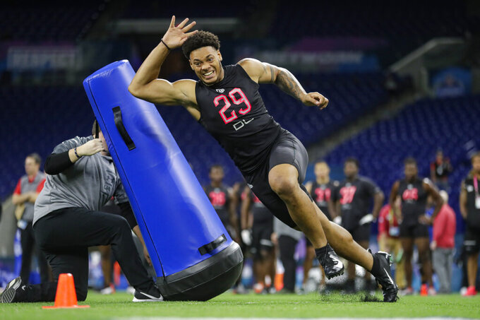 FILE - In this Feb. 29, 2020, file photo, Penn State defensive lineman Yetur Gross-Matos runs a drill at the NFL football scouting combine in Indianapolis. Gross-Matos was selected by the Carolina Panthers in the second round of the NFL football draft Friday, April 24, 2020. (AP Photo/Michael Conroy, File)