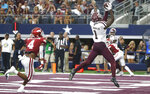 Texas A&M wide receiver Quartney Davis (1) catches a touchdown pass as Arkansas defensive back Jarques McClellion (4) looks on during the second half of an NCAA college football game Saturday, Sept. 28, 2019, in Arlington, Texas. Texas A&M won 31-27. (AP Photo/Ron Jenkins)