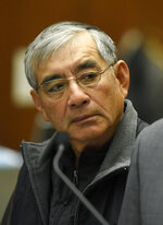 ADDS TO CLARIFY - IN ILLEGAL CAMPAIGN CONTRIBUTIONS TO COMMITTEES THAT SUPPORTED Real estate developer Samuel Leung appears in court as he faces charges of making nearly $200,000 in illegal campaign contributions to committees that supported Los Angeles Mayor Eric Garcetti and other Los Angeles politicians, in Los Angeles County Superior Court on Friday, Feb. 23, 2018, in Los Angeles. (AP Photo/Chris Pizzello)