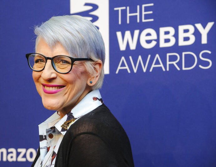 FILE - In this May 13, 2019 file photo, Lisa Lampanelli attends the 23rd annual Webby Awards at Cipriani Wall Street in New York. Lampanelli can be forgiven if she didn't laugh when an impostor showed up at her home. Fairfield police say they responded to the comedian's home last week after her sister said she got a phone call from a woman claiming to be Lampanelli.  The woman said she was at her house but was locked out and couldn't remember where the spare key was. Police say the real Lampanelli was out of state at the time.  (Photo by Christopher Smith/Invision/AP, File)