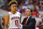 Indiana coach Archie Miller, right, talks with guard Romeo Langford during the first half of the team's NCAA college basketball game against Wisconsin in Bloomington, Ind., Tuesday, Feb. 26, 2019. Indiana won 75-73 in double overtime. (AP Photo/AJ Mast)