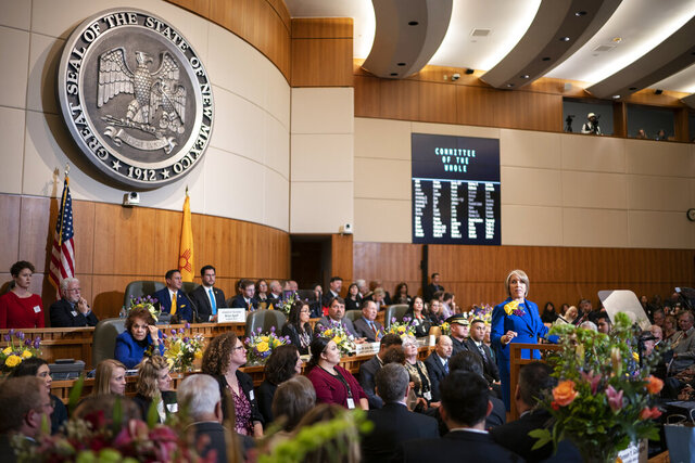 New Mexico Gov. Michelle Lujan Grisham gives her State of the State address during the opening of the New Mexico legislative session in the House chambers at the state Capitol in Santa Fe, N.M. on Tuesday, Jan. 21, 2020. (AP Photo/Craig Fritz)
