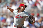 Philadelphia Phillies starting pitcher Aaron Nola (27) delivers in the first inning of a baseball game against the Atlanta Braves Thursday, Sept. 19, 2019, in Atlanta. (AP Photo/John Bazemore)
