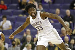 Washington's Isaiah Stewart reacts after scoring late in the second half of the team's NCAA college basketball game against Montana pm Friday, Nov. 22, 2019, in Seattle. Washington won 73-56. (AP Photo/Elaine Thompson)