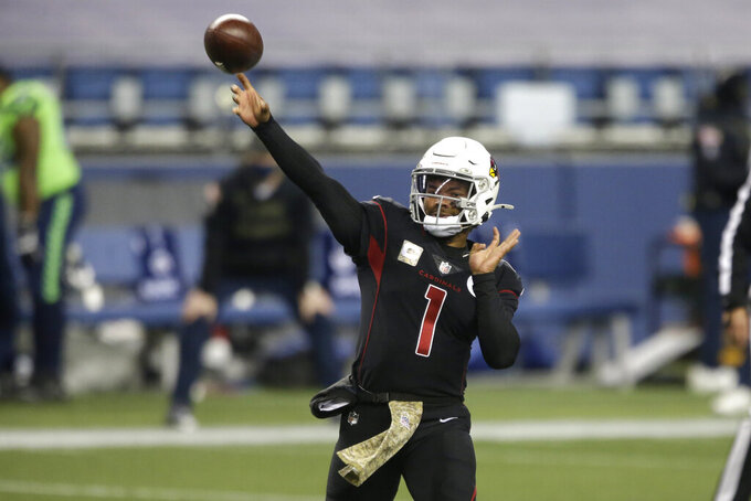 Arizona Cardinals quarterback Kyler Murray passes against the Seattle Seahawks during the first half of an NFL football game, Thursday, Nov. 19, 2020, in Seattle. (AP Photo/Lindsey Wasson)