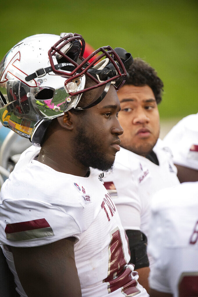 Troy defensive tackle Marcus Webb, left, watches the final minutes of their NCAA college football game against Missouri from the bench Saturday, Oct. 5, 2019, in Columbia, Mo. Missouri won the game 42-10. (AP Photo/L.G. Patterson)