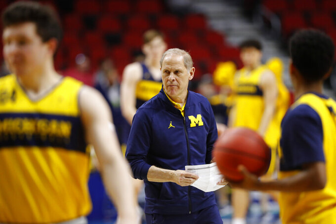 Michigan head coach John Beilein watches his team during practice at the NCAA men's college basketball tournament, Wednesday, March 20, 2019, in Des Moines, Iowa. Michigan plays Montana on Thursday. (AP Photo/Charlie Neibergall)