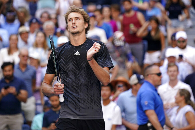 Alexander Zverev, of Germany, celebrates after winning his match against Jannik Sinner, of Italy, in the fourth round of the US Open tennis championships, Monday, Sept. 6, 2021, in New York. (AP Photo/Seth Wenig)