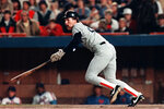 FILE - In this Oct. 25, 1986, file photo, Boston Red Sox' Wade Boggs hits a leadoff single against the New York Mets in sixth game of the World Series at New York's Shea Stadium. Boggs was drafted in the seventh round of the Baseball Draft in 1976, made it to the pros in 1982 and the following year won his first of five batting titles. (AP Photo/Rusty Kennedy, File)