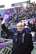 Fiorentina president Rocco Commisso salutes prior to the start of an Italian Serie A soccer match between Bologna and Fiorentina, at the Renato Dall'Ara stadium in Bologna, Italy, Monday, Jan. 6, 2020. ( Massimo Paolone/LaPresse via AP)