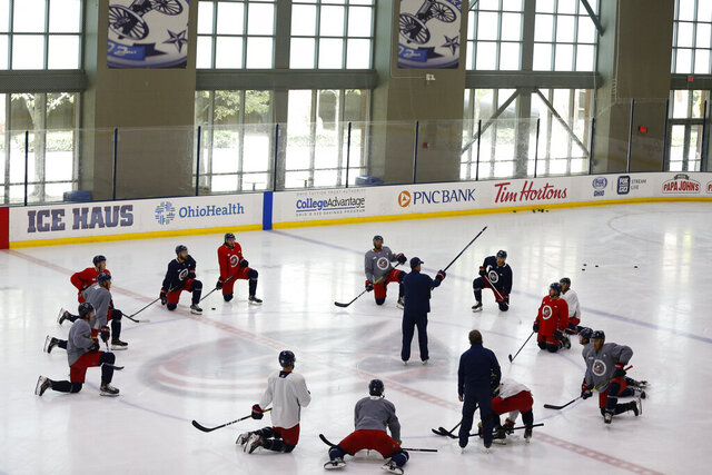 Columbus Blue Jackets' coaches talk with players during the NHL hockey team's practice Monday, July 20, 2020, in Columbus, Ohio. (AP Photo/Jay LaPrete)