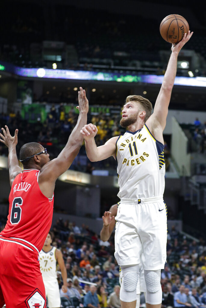 Indiana Pacers forward Domantas Sabonis (11) shoots over Chicago Bulls forward Cristiano Felicio (6) during the first half of an NBA preseason basketball game in Indianapolis, Friday, Oct. 11, 2019. (AP Photo/Michael Conroy)