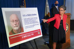 Audrey Strauss, Acting United States Attorney for the Southern District of New York, points to an image depicting Robert Hadden during a news conference to announce his arrest and indictment, Wednesday, Sept. 9, 2020, in New York. Hadden, a former New York gynecologist, is accused of sexually abusing more than two dozen patients, including the wife of former presidential candidate Andrew Yang. He was charged with six counts of inducing others to travel to engage in illegal sex acts. (AP Photo/John Minchillo)