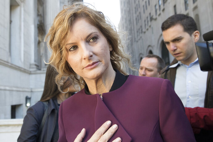 In this Oct. 18, 2018 file photo, Summer Zervos leaves New York state appellate court in New York. A New York appeals court has ruled that President Donald Trump isn't immune from a defamation lawsuit filed by the former