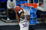 Kansas guard Ochai Agbaji (30) drives to the basket against USC during the first half of a men's college basketball game in the second round of the NCAA tournament at Hinkle Fieldhouse in Indianapolis, Monday, March 22, 2021. (AP Photo/Paul Sancya)