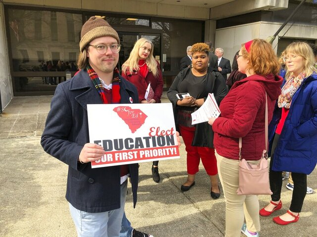 High school English teacher Steve Nuzum of Columbia holds up his sign supporting education with a group of fellow teachers at the Statehouse grounds on Wednesday, Jan. 29. 2020, in Columbia, S.C.. Nuzum took a day off to come to the capitol to support grassroot teachers group SC for Ed. (AP Photo / Jeffrey Collins)