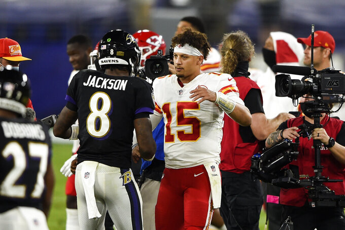 Baltimore Ravens quarterback Lamar Jackson (8) and Kansas City Chiefs quarterback Patrick Mahomes (15) embrace after an NFL football game Monday, Sept. 28, 2020, in Baltimore. The Chiefs won 34-20. (AP Photo/Gail Burton)