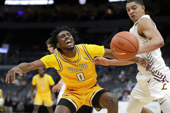 Valparaiso's Javon Freeman-Liberty (0) loses control of the ball after colliding with Loyola of Chicago's Lucas Williamson during the first half of an NCAA college basketball game in the quarterfinal round of the Missouri Valley Conference men's tournament Friday, March 6, 2020, in St. Louis. (AP Photo/Jeff Roberson)