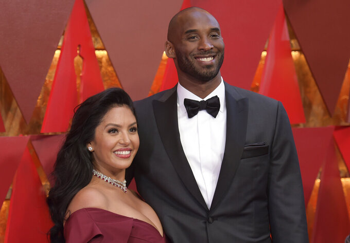 "FILE - In the Sunday, March 4, 2018, file photo, Vanessa Laine Bryant, left, and Kobe Bryant arrive at the Oscars at the Dolby Theatre in Los Angeles. Vanessa Bryant says she is focused on ""finding the light in darkness"" in an emotional story in People magazine. She details how she attempts to push forward after her husband, Kobe Bryant, and daughter Gigi died in a helicopter crash in early 2020. (Photo by Richard Shotwell/Invision/AP, File)"