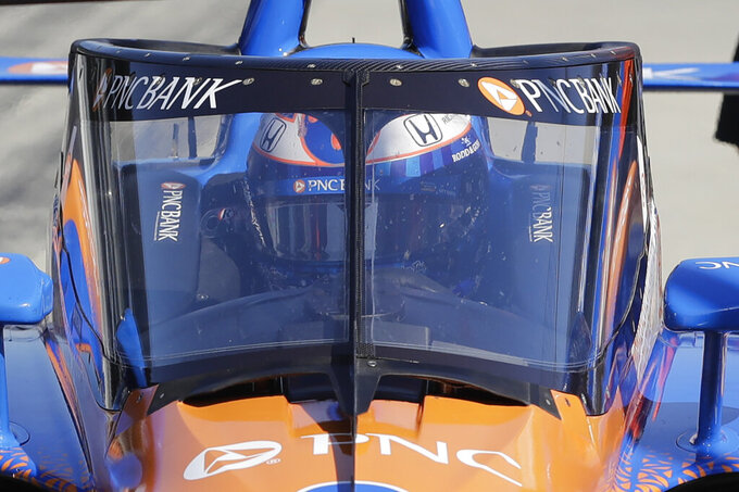 FILE - In this Wednesday, Oct. 2, 2019, file photo, Scott Dixon, of New Zealand, sits in his car during the Aeroscreen testing at Indianapolis Motor Speedway in Indianapolis. After 10 months of testing, the canopy-shaped cockpit protection is intended to protect the driver from debris. (AP Photo/Darron Cummings)