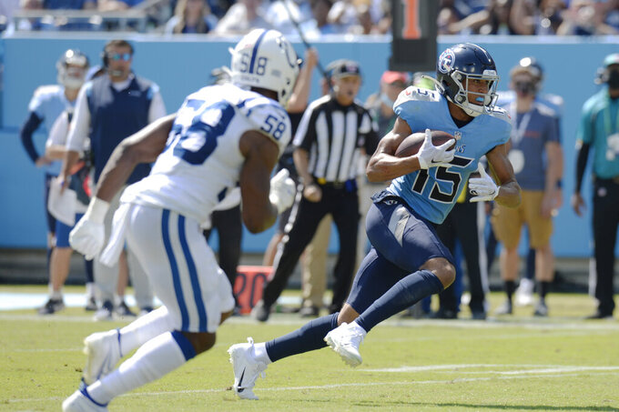 Tennessee Titans wide receiver Nick Westbrook-Ikhine (15) gets past Indianapolis Colts inside linebacker Bobby Okereke (58) to score a touchdown in the first half of an NFL football game Sunday, Sept. 26, 2021, in Nashville, Tenn. (AP Photo/Mark Zaleski)