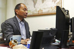 "In this Oct. 15, 2019, photo, Berlin Wall political scientist Francis Fukuyama works at his desk at Stanford University in Stanford, Calif. Months before the fall of the Berlin Wall on Nov. 9, 1989, with Soviet power and its stranglehold over the eastern European bloc crumbling, Fukuyama made a declaration that quickly became famous. It was, he declared, ""the end of history."" (AP Photo/Haven Daley)"