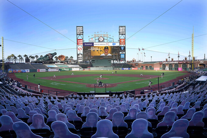 FILE - Cardboard cutouts rest in seats at Oracle Park as the San Francisco Giants play the San Diego Padres during the first inning of a baseball game in San Francisco, in this Wednesday, July 29, 2020, file photo. (AP Photo/Tony Avelar, File)