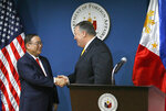 U.S. State Secretary Mike Pompeo, right, bids goodbye to Philippine Foreign Affairs Secretary Teodoro Locsin Jr. following their joint news conference in suburban Pasay city southeast of Manila, Philippines Friday, March 1, 2019. Pompeo, who joined U.S. President Donald Trump in the second summit with North Korean leader Kim Jong-un in Vietnam, is here for talks on the two countries' relations as well as the mutual defense treaty. (AP Photo/Bullit Marquez)