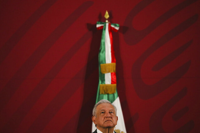Mexico's President Andres Manuel Lopez Obrador gives his daily news conference at the presidential palace in Mexico City, early Thursday, March 19, 2020. (AP Photo/Fernando Llano)