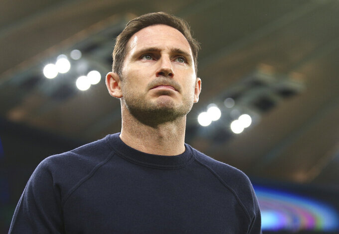 Chelsea's head coach Frank Lampard follows the game during the Champions League Group E soccer match between Krasnodar and Chelsea in Krasnodar, Russia, Wednesday, Oct. 28, 2020. (AP Photo)