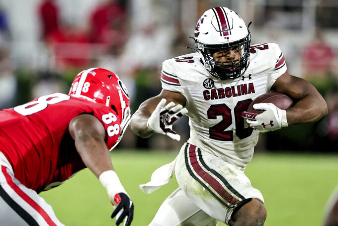 South Carolina running back Kevin Harris (20) tries to get around Georgia defensive lineman Jalen Carter (88) during the second half of an NCAA college football game Saturday, Sept. 18, 2021, in Athens, Ga. Georgia won 40-13. (AP Photo/Butch Dill)