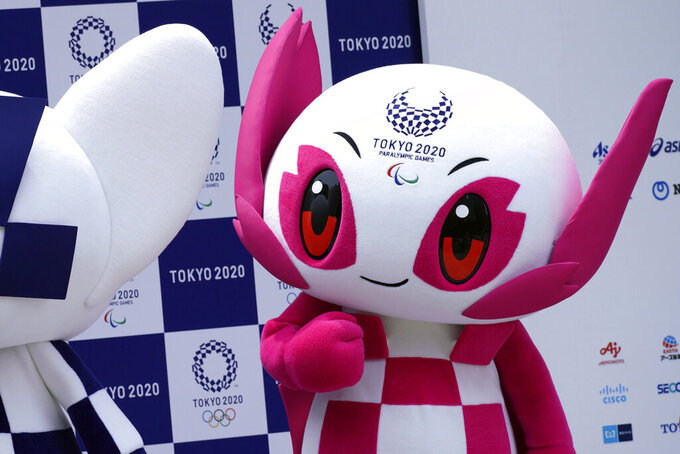 "FILE - In this July 22, 2018, file photo, Tokyo 2020 Paralympic mascot ""Someity"" stands at stage during their debut event in Tokyo. The Tokyo 2020 Paralympic schedule remains essentially unchanged for the event postponed until next year, organizers said on Monday, Aug. 3, 2020. Tokyo organizers made the same announcement several weeks ago for the postponed Olympics. The Paralympics open on Aug. 24, 2021, and close on Sept. 5. The Olympics are to open on July 23. (AP Photo/Eugene Hoshiko, File)"