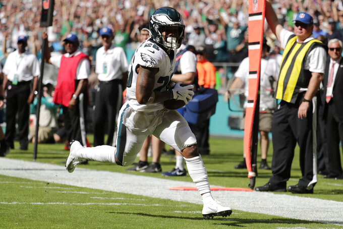Philadelphia Eagles running back Miles Sanders (26) scores a touchdown during the first half of an NFL football game against the Miami Dolphins, Sunday, Dec. 1, 2019, in Miami Gardens, Fla. (AP Photo/Lynne Sladky)