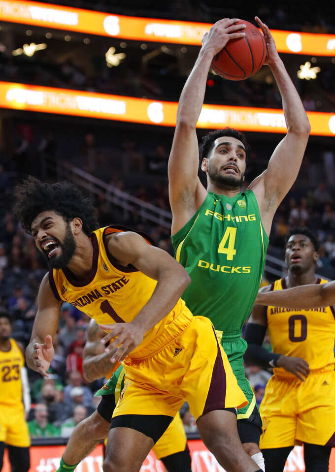 Oregon's Ehab Amin, right, grabs a rebound over Arizona State's Remy Martin during the second half of an NCAA college basketball game in the semifinals of the Pac-12 men's tournament Friday, March 15, 2019, in Las Vegas. (AP Photo/John Locher)