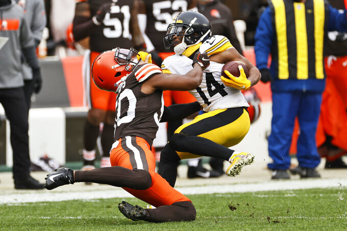Cleveland Browns linebacker Jacob Phillips (50) tackles Pittsburgh Steelers wide receiver Ray-Ray McCloud (14) during the first half of an NFL football game, Sunday, Jan. 3, 2021, in Cleveland. (AP Photo/Ron Schwane)